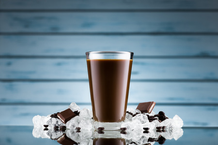 ice crushed: Iced coffee in glass and crushed ice on blue background Stockfoto