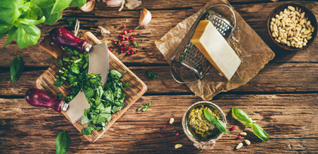 italian cuisine: Pesto sauce and ingredients on old wooden table, vintage style