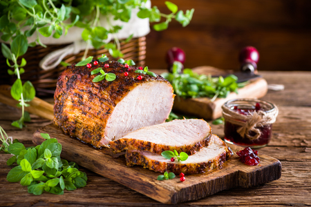 loin: Roasted pork loin with cranberry and marjoram