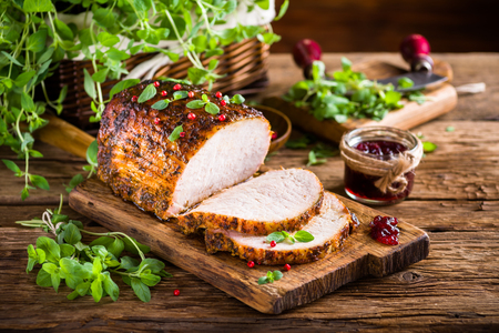 Roasted pork loin with cranberry and marjoram Stok Fotoğraf - 48060793