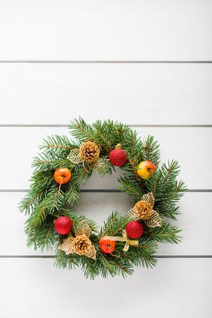 evergreen: Christmas wreath on white wooden table top view