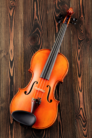 Close up of a violin on wooden table