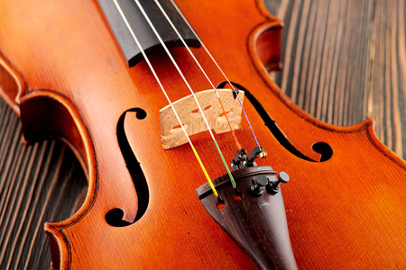 Close up of a violin detail on wooden table Stock Photo
