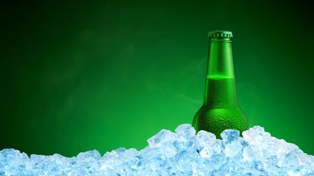 alcohol drinks: Bottle of cold beer in ice on green background
