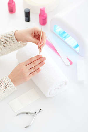 Manicure and hybrid nails painting process.