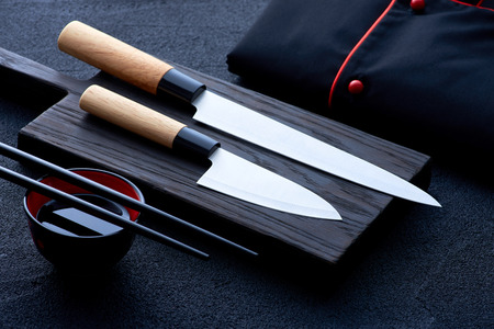 Asian kitchen chef accessories on black stone table 免版税图像