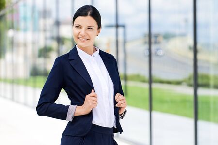 self assurance: Portrait of self confidence business woman next to the office Stock Photo
