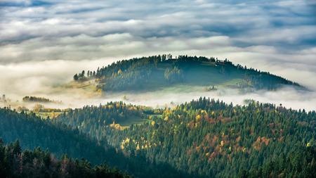 Misty sunrise landscape from Luban peak in Gorce mountains, Poland
