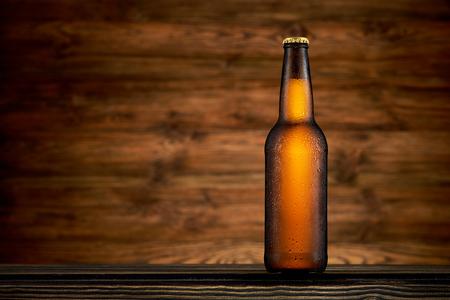 Bottle of cold beer on wooden background Zdjęcie Seryjne