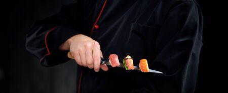 Sushi served on japanese knife in chef hand Zdjęcie Seryjne