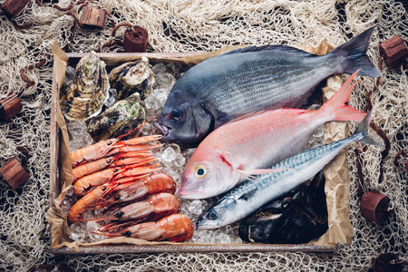 Fresh spanish fish and seafood in wooden box