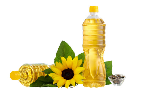 Bottle of sunflower oil on the table isolated Zdjęcie Seryjne