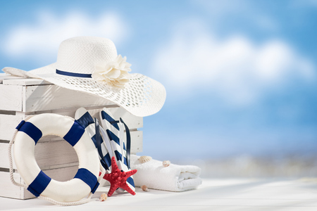 Summer accessories on white wooden table, sky in background Zdjęcie Seryjne