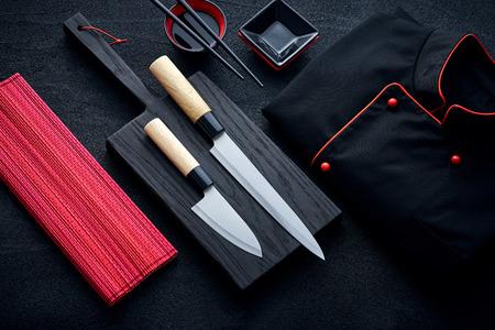 Asian kitchen chef accessories on black stone table Zdjęcie Seryjne