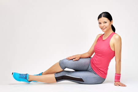 Smiling woman at the gym, fitness studio concept