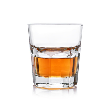 Glass of whisky on a white background. photo