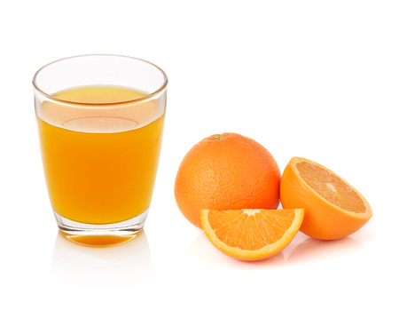 orange slice: Fresh orange and glass with juice Stock Photo