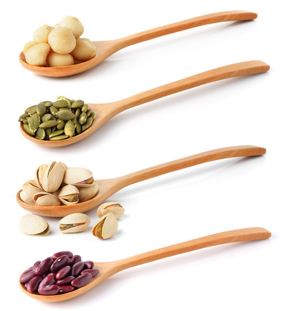 Red beans,pistachios nuts, pumpkin seeds and macadamia isolated photo