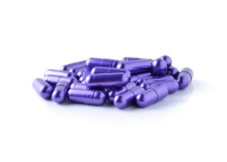 分離した白地に紫の丸薬