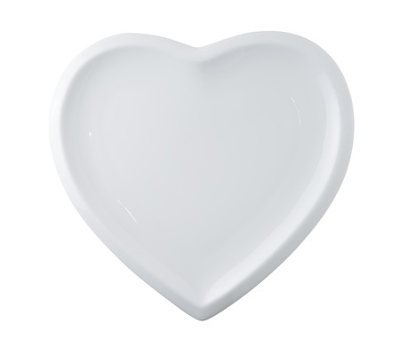 white plate in shape of heart isolated on white