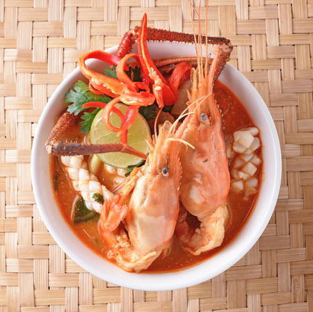 Tom Yum seafood soup or spicy tom yum seafood soup ,Thai food photo