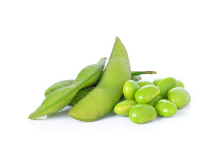 Green soybeans on white background photo