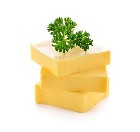 mantequilla: mantequilla en el fondo blanco Foto de archivo