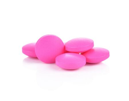 group therapy: pink pills on a white background