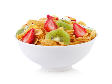 bowl of corn flakes with fruit on white background
