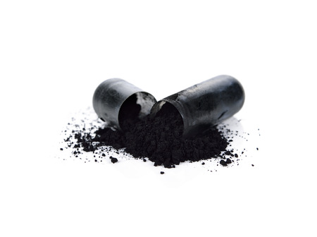 Charcoal capsules isolated on white background