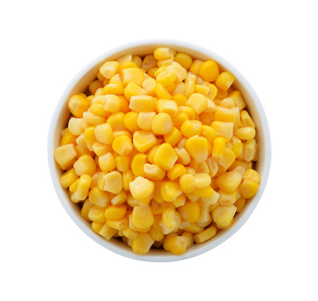 vegetable tin: corn in a bowl on a white background Stock Photo