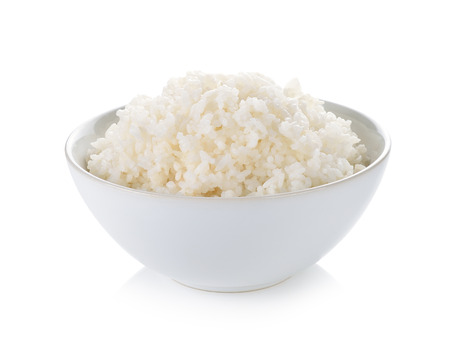 Rice in a bowl on white background Standard-Bild