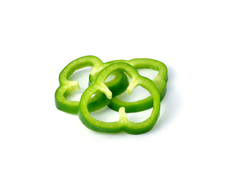 pimiento: Sliced green pepper isolated on white