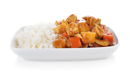 Curry and rice on white background. Foto de archivo
