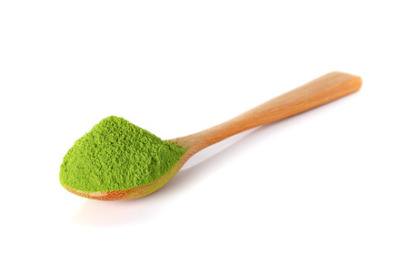 dry powder: powder green tea with bamboo spoon isolated on white background Stock Photo
