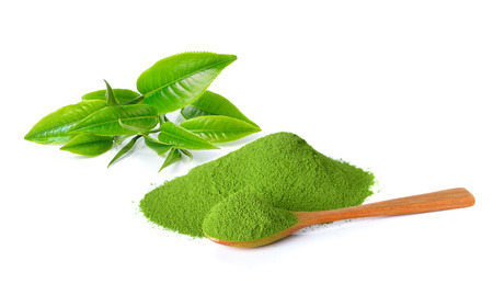 matcha: powder green tea and green tea leaf isolated on white background