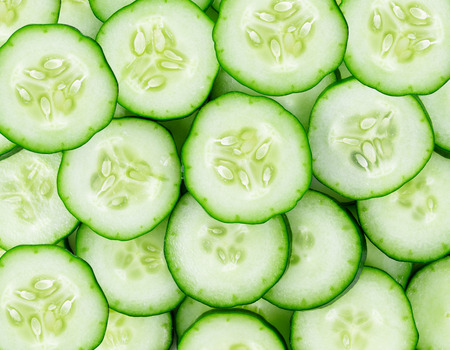 Close up of fresh cucumber slices background