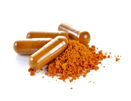 tumeric: Tumeric powder capsules on white background Stock Photo