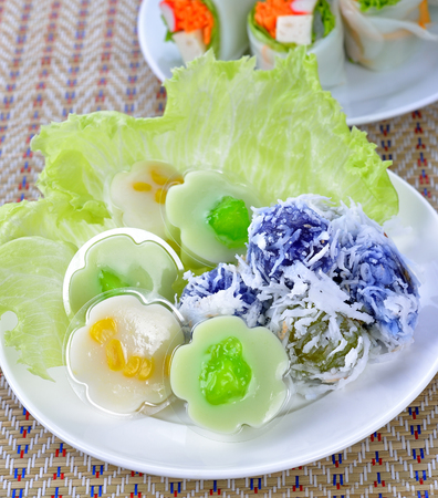 dessert topping: Thai dessert. Flour stuffed with sweet coconut, and grated coconut topping on plate.