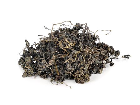 thea: Heap of dried green tea on white background