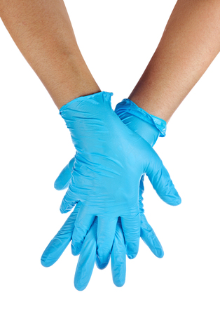 latex gloves: Hands of a medic wearing a blue latex gloves