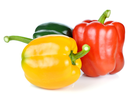 over white background: colored peppers over white background