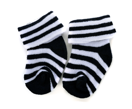 children s feet: Pair of childs striped socks on a white background