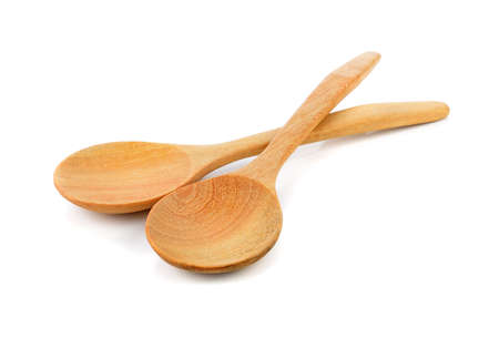 isolated on yellow: Wooden spoon on white background