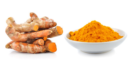 lon: Turmeric roots with turmeric powder isolated on white background