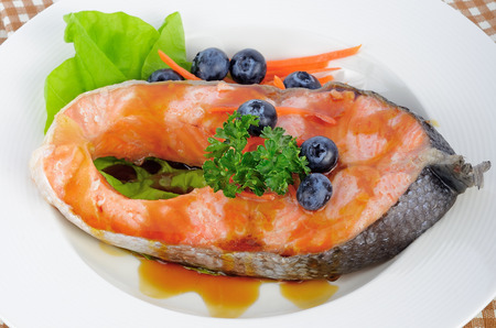 gill: salmon steak with vegetables and fruit. Stock Photo