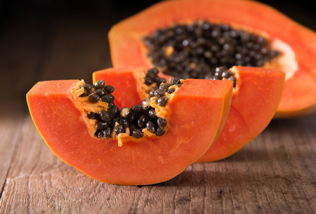 papaya fruit on wooden board Stock Photo