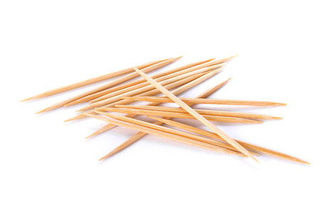 Wooden toothpicks on white background