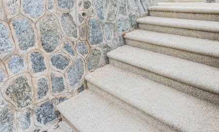sand mold: Weathered concrete stairs with mold, faded paint.,crumbling. on the beach