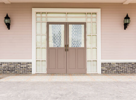 double glass: Entrance vintage House  leading to a double glass paned front door with two large front lanterns Stock Photo